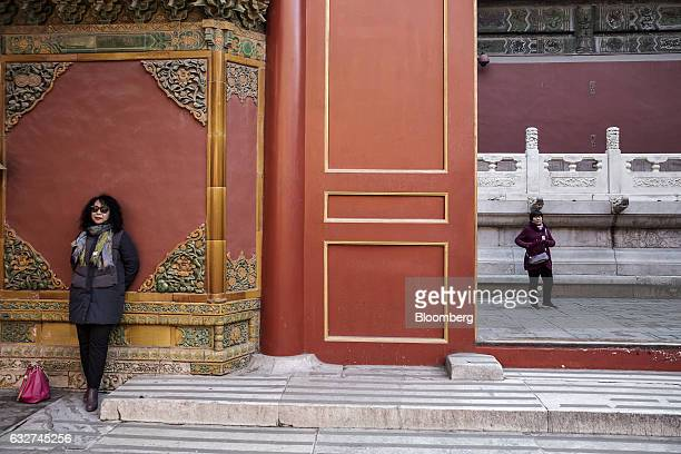 A visitor leans against a wall inside the Palace Museum at the Forbidden City in Beijing China on Thursday Nov 24 2016 Beijings Palace Museum...