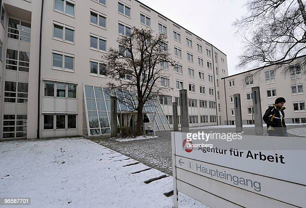 A visitor leaves an unemployment office or Arbeitsagentur in Rosenheim Germany on Tuesday Jan 5 2010 German unemployment unexpectedly fell in...