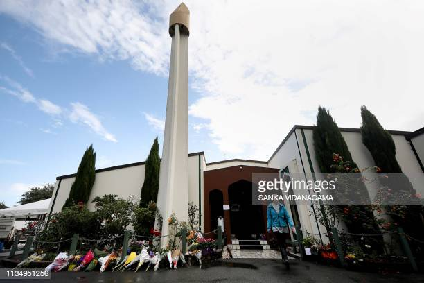 A visitor leaves the Al Noor mosque one of the mosques where some 50 people were killed by a selfavowed white supremacist gunman on March 15 after...