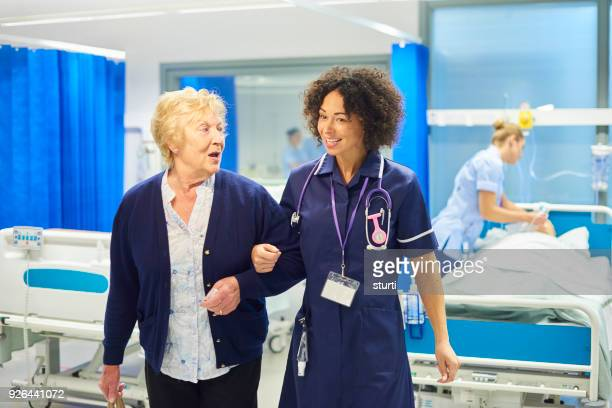 visitor leaving hospital - sturti stock pictures, royalty-free photos & images