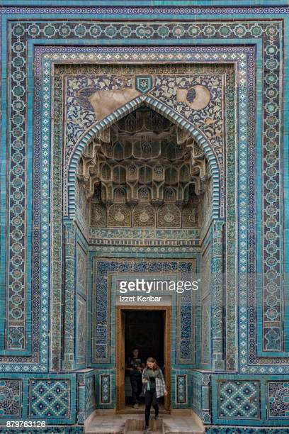Visitor leaving the entrance of a madrasah at Sheikh Zinda Necropolis, Samarkand, Uzbekistan
