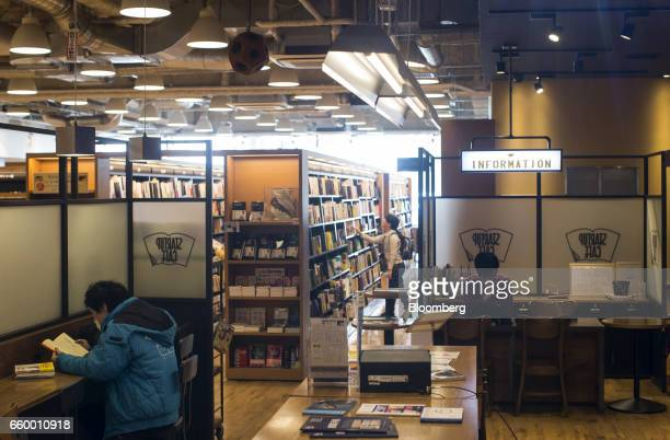 A visitor left reads a book in the Startup Cafe located inside the Tsutaya Bookstore in the Tenjin area of Fukuoka Japan on Saturday March 4 2017...