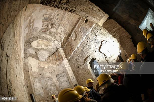 Visitor look around one of the rooms of of the Domus Aurea a large palace built by the Roman Emperor Nero in the first century during a exhibition...