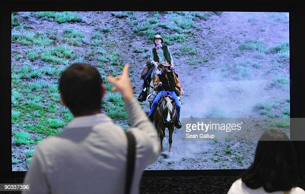 A visitor look at a 150inch plasma television at the Panasonic stand on opening day at the IFA technology trade fair on September 4 2009 in Berlin...