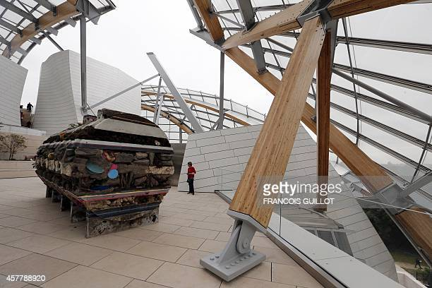 A visitor look at the piece 'Where the slaves live' by Argentinian artist Adrian Villar Rojas during an open day at the Fondation Louis Vuitton in...