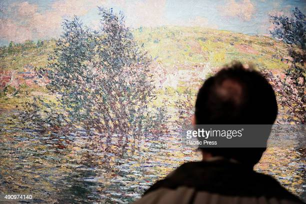 A visitor looking at the painting of Claude Monet From 2 October to 31 January 2016 at the Gallery of Modern Art the forty masterpieces and including...