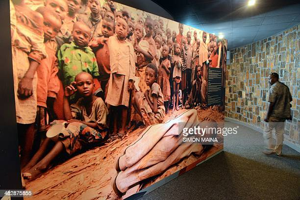 A visitor looks a large picture of children victims of the 1994 Rwandan genocide on April 4 2014 the Kigali Genocide Memorial Centre in Kigali Twenty...
