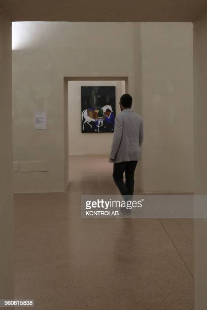 PIEMONTE SALUZZO CUNEO ITALY Visitor looks a painting of Iranian artist Mohamad Hadi Fadavi during the opening of exhibition Diario Persiano at...