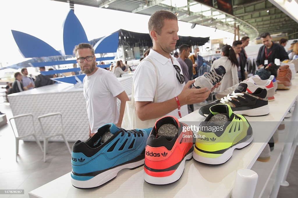 A visitor looks among Torsion Alegra shoes at the adidas Originals Spring/Summer 13 collection at the Bread and Butter 2012 fashion trade fair on July 4, 2012 in Berlin, Germany.