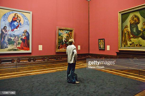 Visitor looks around at the opening of the exhibition 'Himmlischer Glanz' with Raffaelo 'Raffael' Santi's paintings 'The Sistine Madonna' and...