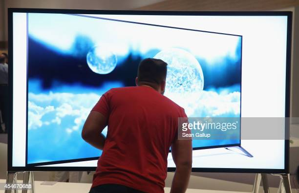A visitor looks at a 4000K television at the Sony stand at the 2014 IFA home electronics and appliances trade fair on September 5 2014 in Berlin...