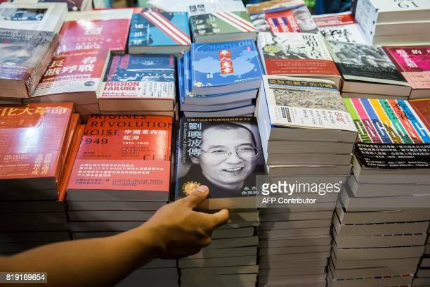 A visitor looks at a biography of the late Chinese Noble laureate Liu Xiaobo at the International Book Fair in Hong Kong on July 20 2017 This year's...