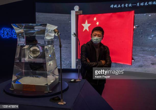Visitor looks at a case holding lunar rock and debris recently collected from the Moon by China's space program that is part of a display at the...