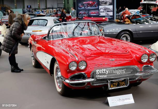 A visitor looks at a Chevrolet Corvette Roadster 1961 displayed during a press preview before a mass auction of vintage vehicles organised by Bonhams...
