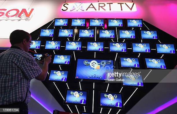 A visitor looks at a display of Smart TV televisions at the Thomson stand at the IFA 2011 consumer electonics and appliances trade fair on the first...
