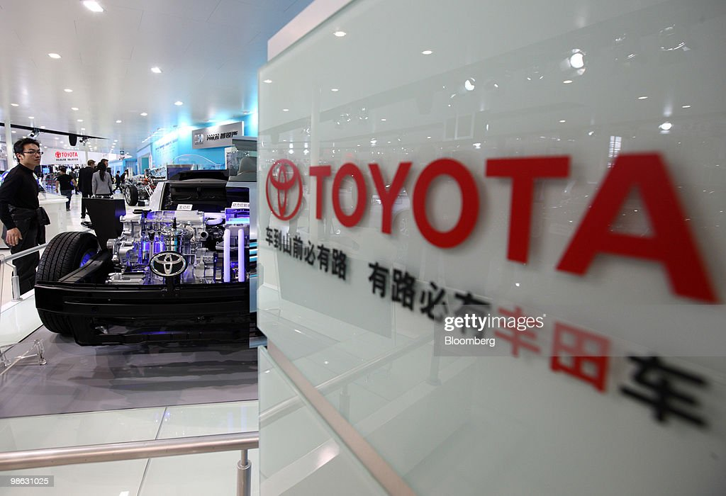 A visitor looks at a display of Toyota Motor Corp.'s Camry Hybrid sedan at the Beijing Auto Show in Beijing, China, on Friday, April 23, 2010. The show will be held through April 27. Photographer: Tomohiro Ohsumi/Bloomberg via Getty Images