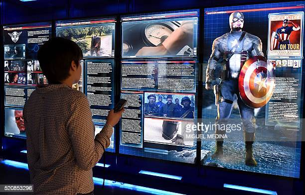 A visitor looks at a display on Marvel Comics superhero Captain America at the interactive Marvel Avengers STATION exhibition in the bussines...
