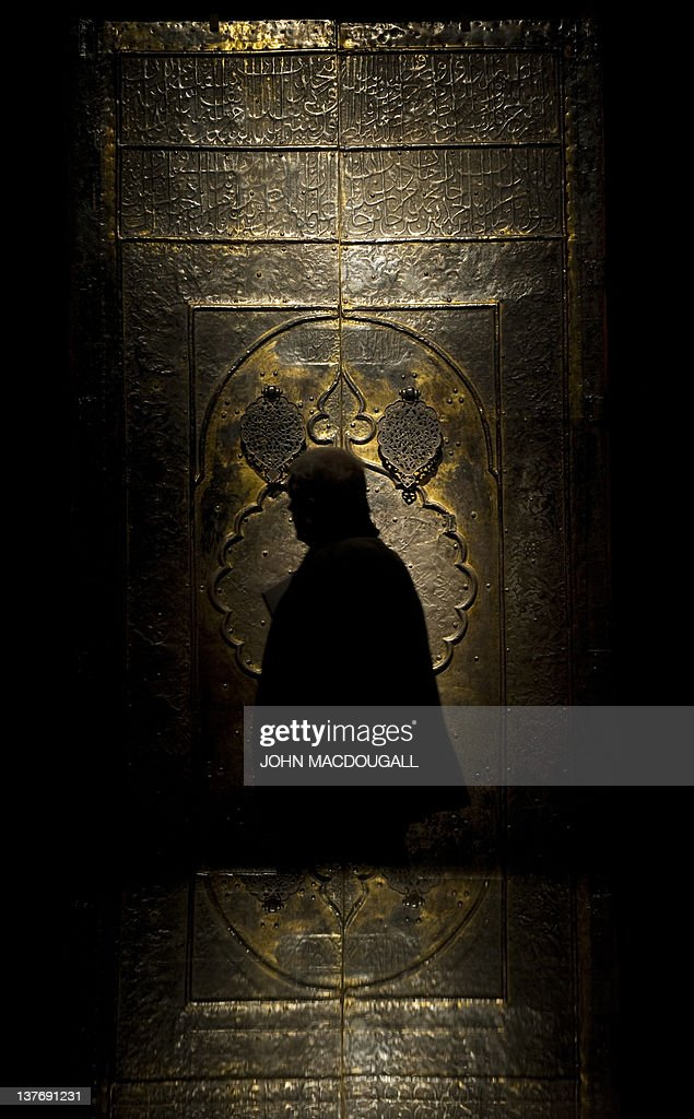 A visitor looks at a gold-plated door of & A visitor looks at a gold-plated door of Pictures | Getty Images