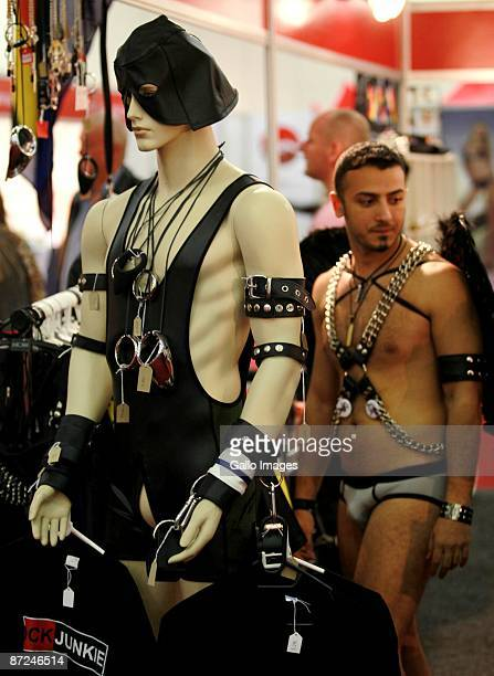 Visitor looks at a mannequin dressed in BDSM apparel at the Cape Town Sexpo on May 14, 2009 in Cape Town, South Africa. The Sexpo is the world's...