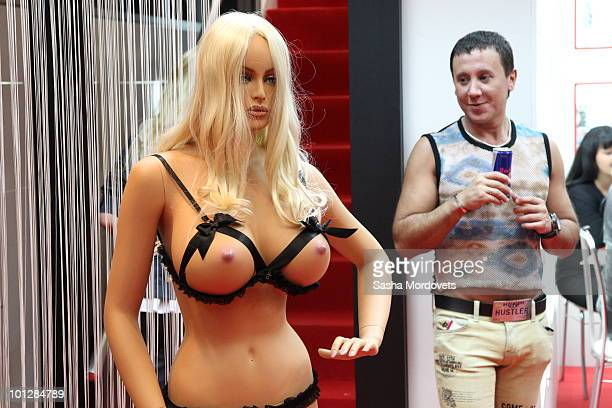 A visitor looks at a mannequin on an exhibition stand at The International Specialized XSHOW Exhibition for Adults 2010 on May 2010 in Moscow Russia...