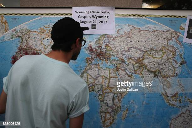 A visitor looks at a map with pins to show where people are visiting from during the Wyoming Eclipse Festival on August 20 2017 in Casper Wyoming...