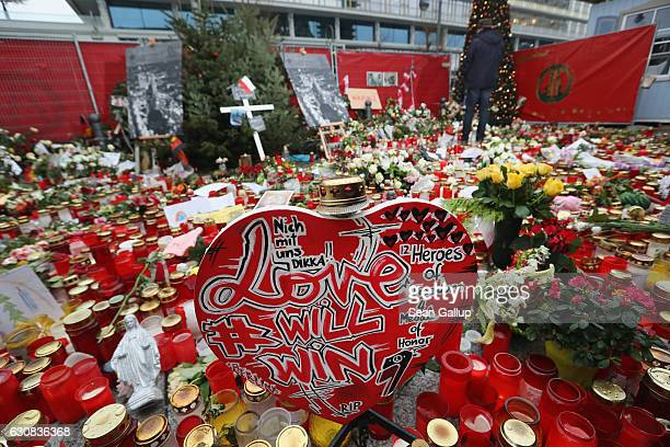 A visitor looks at a memorial to victims of the December 19 terror attack at a Christmas market on January 3 2017 in Berlin Germany Authorities are...
