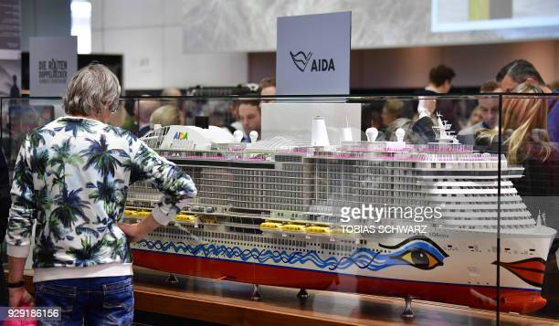 A visitor looks at a mock of the 'AIDAnova' passenger cruise vessel during the International Tourism Trade Fair in Berlin on March 8 2018 The...