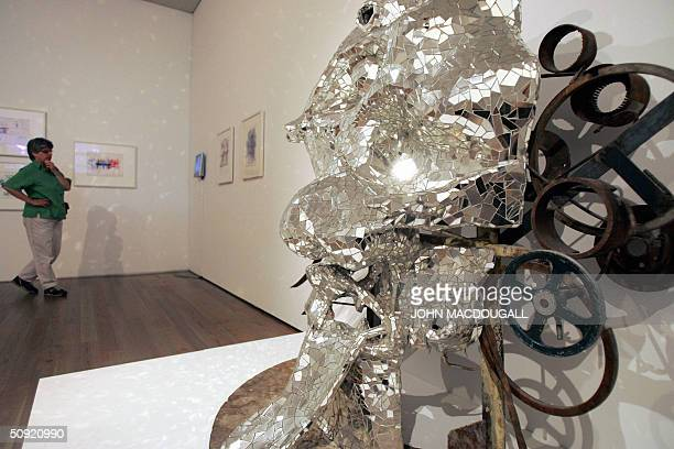 Visitor looks at a model of Jean Tinguely's giant museum-sculpture intitled Le Cyclop at Jean Tinguely Museum in Basel 02 June 2004. The museum,...