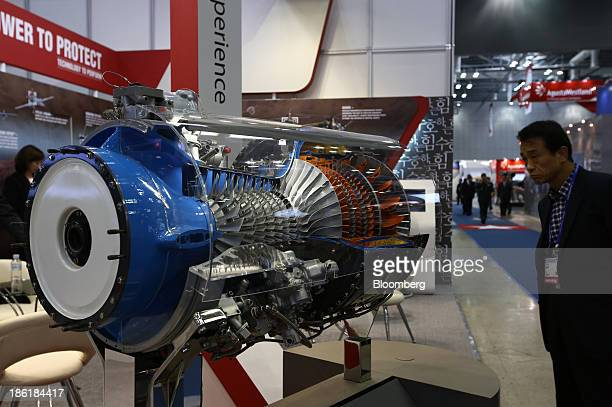 Visitor looks at a model of the Honeywell Aerospace T55 engine at the Seoul International Aerospace & Defense Exhibition 2013 in Goyang, South Korea,...