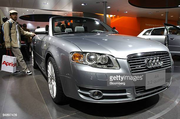 A visitor looks at a new Audi A4 cabriolet at the Tokyo Motor Show Wednesday October 19 2005