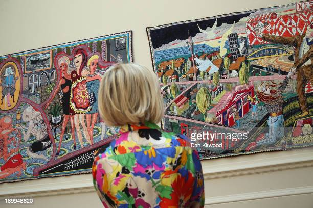 Visitor looks at a one of six new tapestries by turner prize winning artist Grayson Perry RA during the Royal Academy's 'Summer Exhibition' on June...