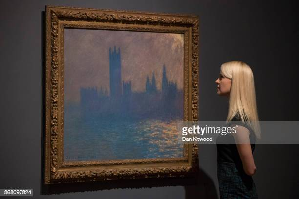 A visitor looks at a Painting by artist Claude Monet during a press preview at the Tate Britain on October 30 2017 in London England The painting...