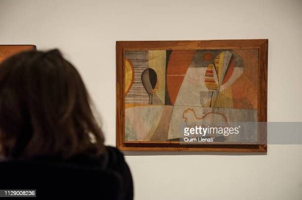 MADRID SPAIN – FEBRUARY 05 A visitor looks at a painting by the artist HC Westermann during the press preview of his exhibition 'Goin'Home' at the...