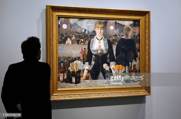 A visitor looks at a painting entitled A bar at the FoliesBergere by Edouard Manet during the opening of The Courtauld Collection A Vision For...