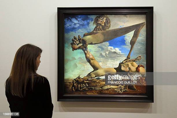 A visitor looks at a painting entitled 'Construction molle avec haricots bouillis' by Spanish surrealist artist Salvador Dali during an exhibition...