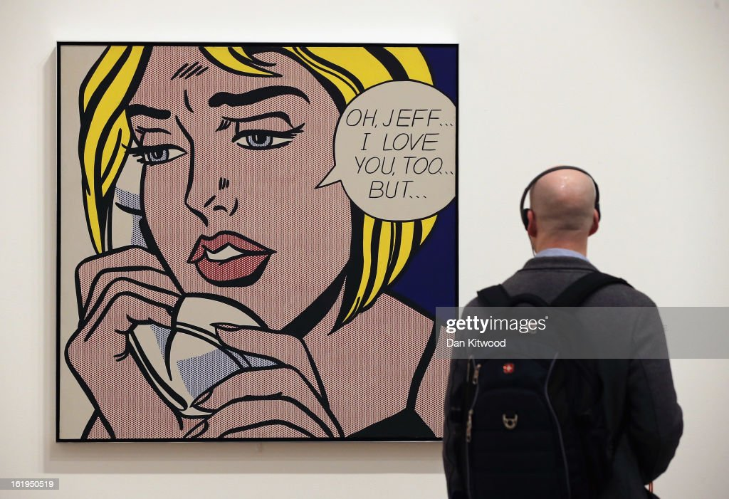 A visitor looks at a painting entitled 'Oh, Jeff... I Love You, Too...But... ' during a press preview of 'Lichtenstein, a Retrospective' at the Tate Modern on February 18, 2013 in London, England. The painting is part of a retrospective exhibition by 1960's Pop Artist Roy Lichtenstein, the first of its kind in 20 years, which runs at the gallery until May 27, 2013.