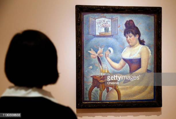 A visitor looks at a painting entitled Young Woman Powdering Herself by Georges Seurat during the opening of The Courtauld Collection A Vision For...