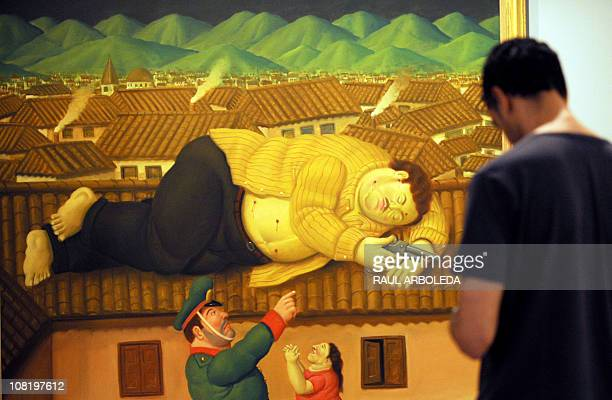 A visitor looks at a painting named Dead Pablo Escobar by Colombian Artist Fernando Botero displayed at the Antioquia Museum in Medellin Antioquia...