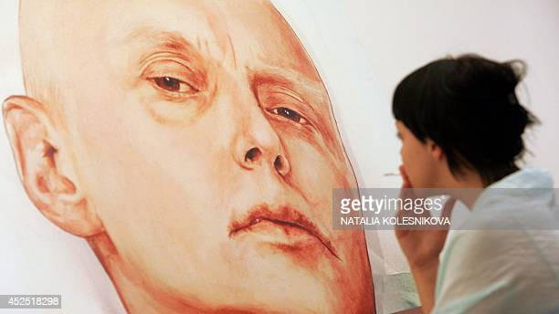 A visitor looks at a painting showing former Russian spy Alexander Litvinenko by Dmitry Vrubel and Viktoria Timofeyeva painters in the Marat Guelman...