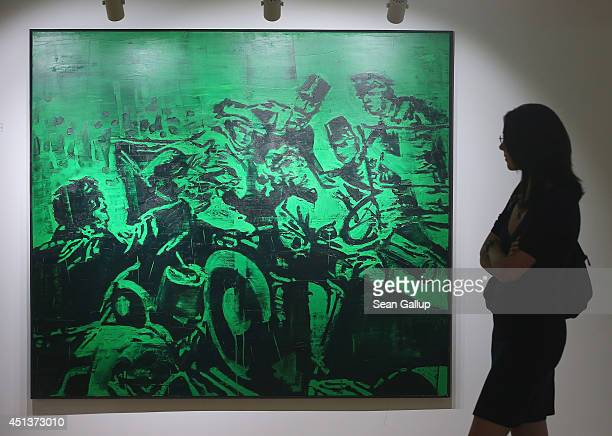 A visitor looks at a painting that depicts Serbian secessionist Gavrilo Princip assassinating Austrian Archduke Franz Ferdinand and his wife Duchess...
