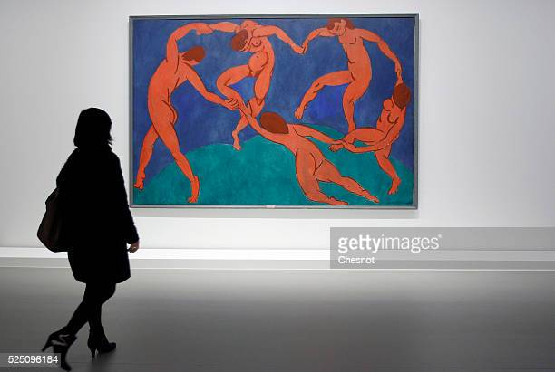 "Visitor looks at a painting The Dance of Henri Matisse as part of the opening of the exhibition ""Keys to a Passion"" at the Louis Vuitton Foundation..."