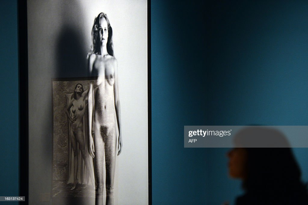 A visitor looks at a photo by German-Australian photographer Helmut Newton during a press preview of the 'White women / Sleepless nights / Big nudes' exhibition at the Palazzo delle Esposizioni on March 5, 2013 in Rome. The exhibition will run from March 6 to July 21, 2013.