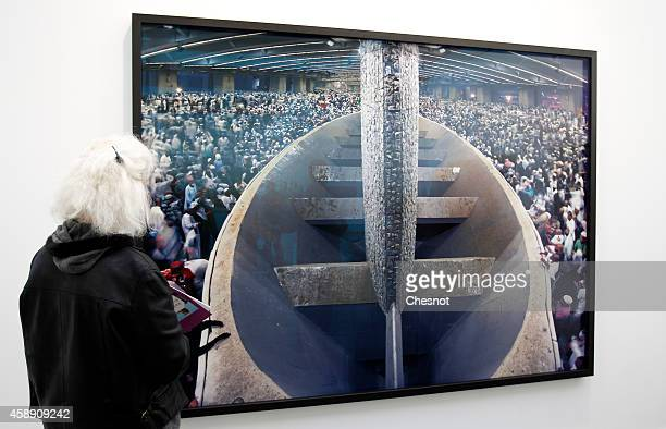 A visitor looks at a photograph by Saudi Arabian photographer Ahmed Mater during the Paris Photo Fair held at the Grand Palais on November 12 2014 in...