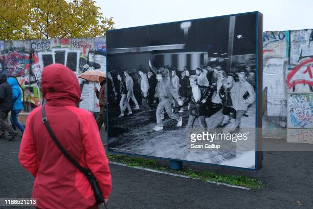 A visitor looks at a photograph from 1989 at Bernholmer Bridge where on November 9 people first crossed unhindered from East Berlin into West Berlin...