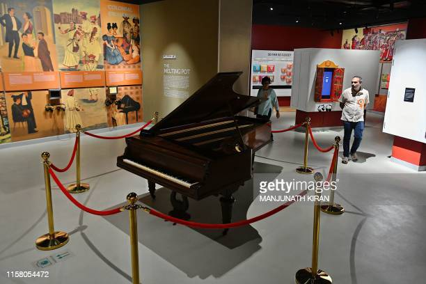 A visitor looks at a piano on display at the Indian Music Experience Indias first interactive music museum in Bangalore on July 27 2019