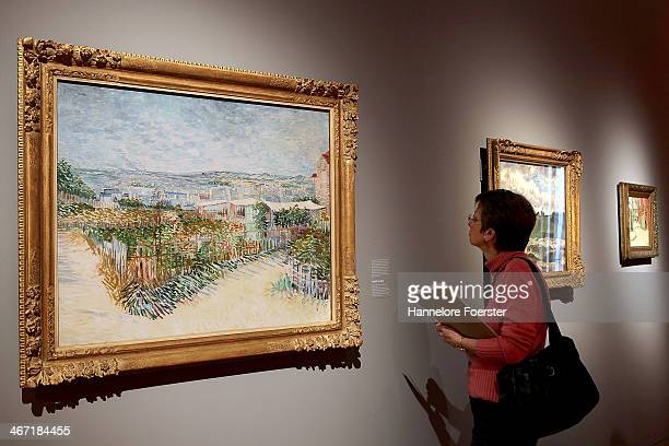 A visitor looks at a picture of Vincent van Gogh at the 'Esprit Mont Martre' exhibition at Schirn Kunsthalle on February 6 2014 in Frankfurt am Main...