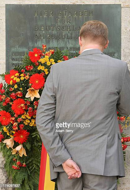 A visitor looks at a plaque dedicated to the memory of the planners of the 1944 assassination attempt on Adolf Hitler on the 69th anniversary of the...