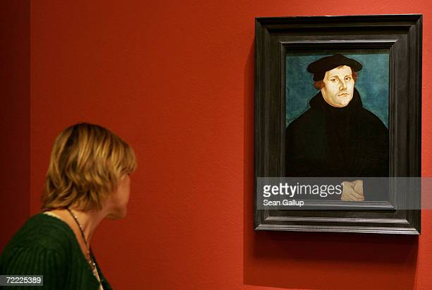 A visitor looks at a portrait of 16thcentury German church reformer Martin Luther by Lucas Cranach the Elder at the German Historical Museum October...