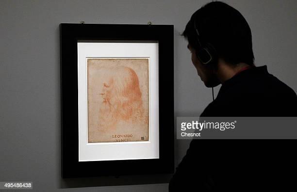 A visitor looks at a portrait of Leonardo da Vinci during the exhibition Leonardo da Vinci il Genio The secrets of the Codex Atlanticus unveiled at...