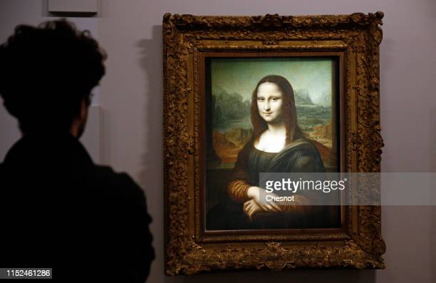A visitor looks at a portrait of Lisa Del Giocondo by the Italian artist Leonardo da Vinci a version of the Mona Lisa displayed during a press...